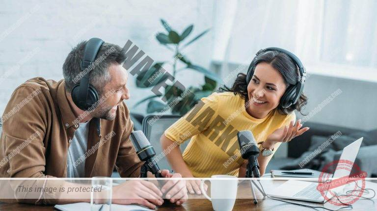 two people wearing headphones during a podcast